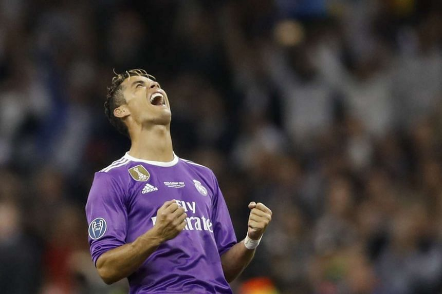 Double scorer Ronaldo celebrates as Real Madrid win the Champions League.
