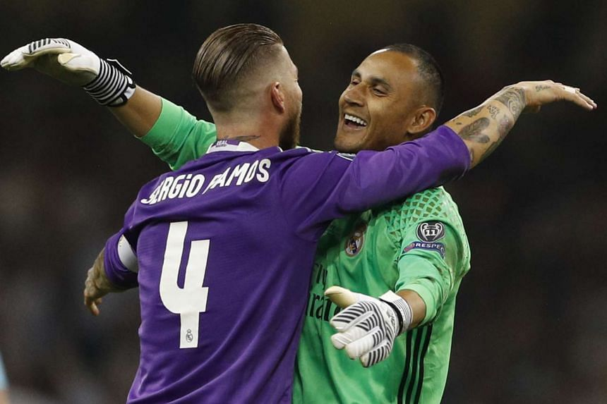 Sergio Ramos and Keylor Navas celebrate after the match.