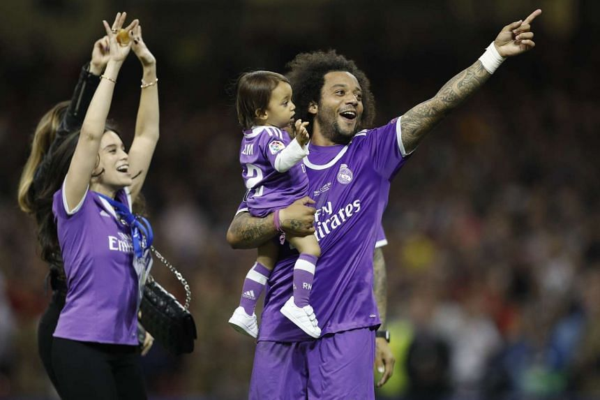 Marcelo celebrates winning with his family.