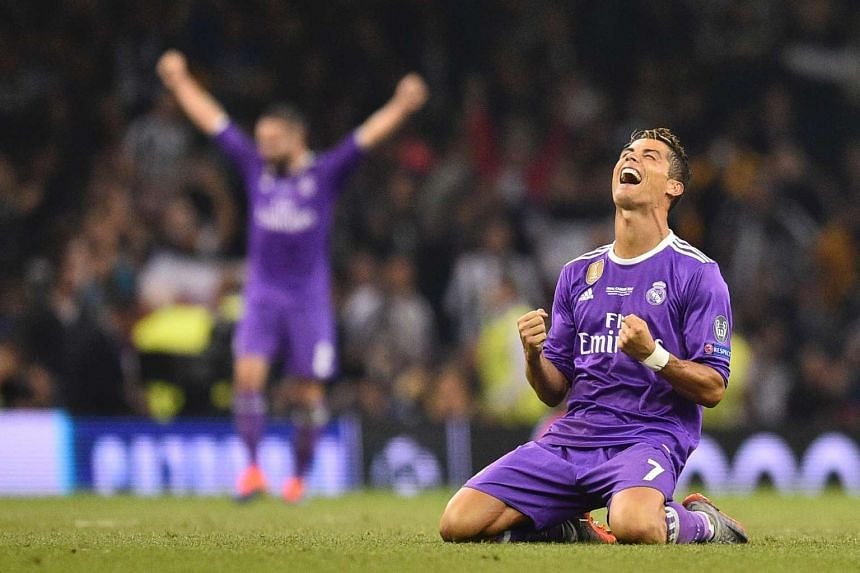 Ronaldo falls to his knees as he celebrates Real Madrid's Champions League victory.