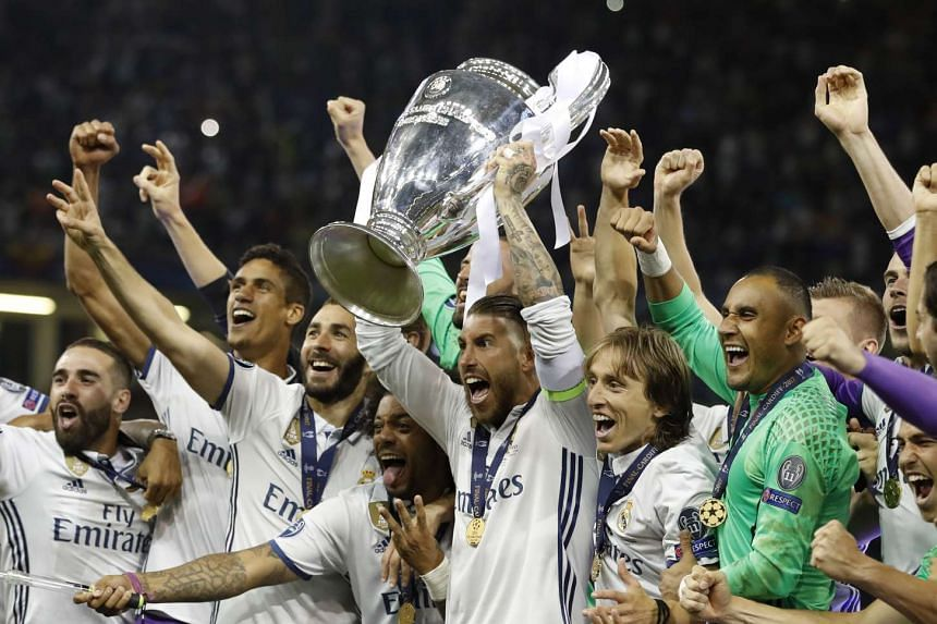 Real Madrid's Sergio Ramos celebrates with the trophy.
