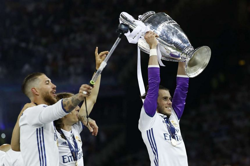 Gareth Bale celebrates with the trophy.