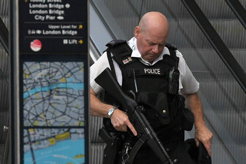 An armed police officer standing on duty at The Shard in the London Bridge area of London on June 4.