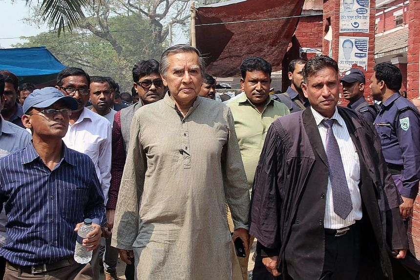 Mr Mahfuz Anam (centre) out on bail in March last year over a defamation case filed against him by pro-government activists. International media and human rights organisations have condemned the cases brought against him as politically motivated and