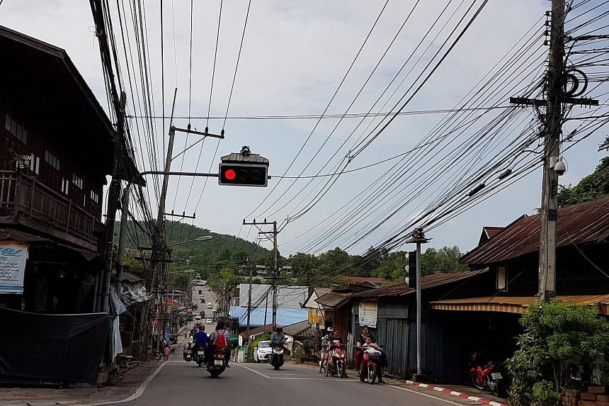 "A sleepy downtown scene in Mae Hong Son province, known for its stunning mountains and ethnic minorities. It was once touted as Thailand's ""happiest"" province. But recent police investigations reveal it hides a bustling child-sex trade, and that has"