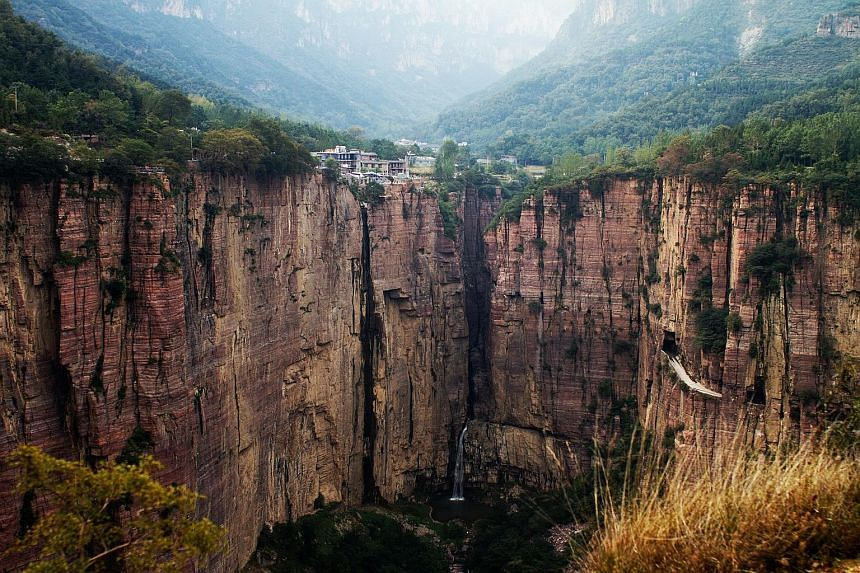 Guoliang Tunnel is carved into China's Taihang Mountains. Tea plantations at Cameron Highlands. A stretch of cafes along Woljeongri Beach. Clear Water Bay is located at the rugged peninsula in south-eastern New Territories and comprises two beaches.