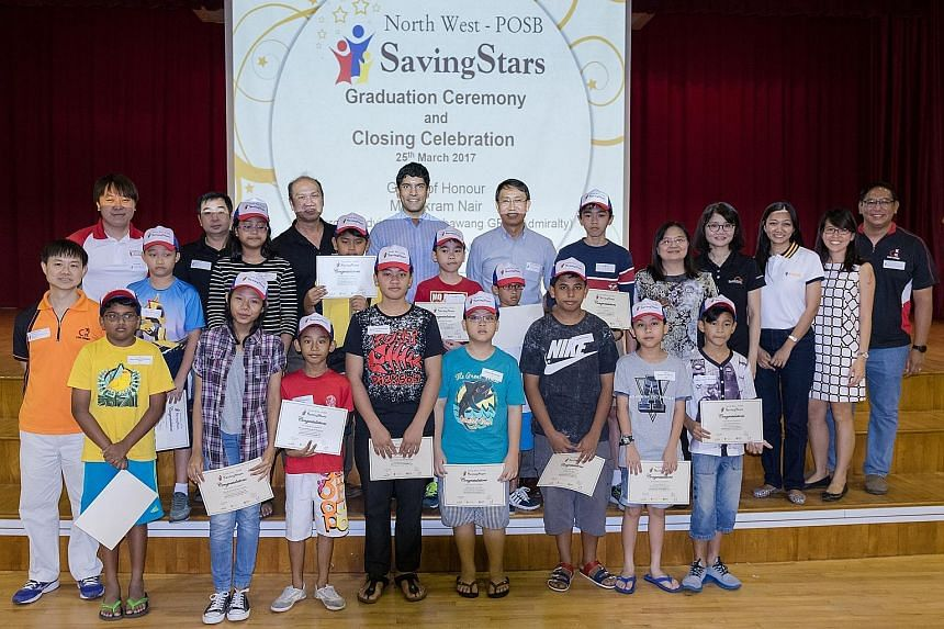 Community development council staff and volunteers from POSB with student participants at the graduation ceremony for the North West POSB Saving Stars programme in March this year.