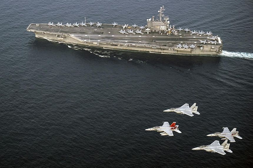 US Navy and Japan Air Self-Defence Force aircraft flying over USS Ronald Reagan in the Sea of Japan (East Sea) last Thursday. US Secretary of Defence James Mattis highlighted the threat that North Korea's nuclear weapons posed to the region, and call