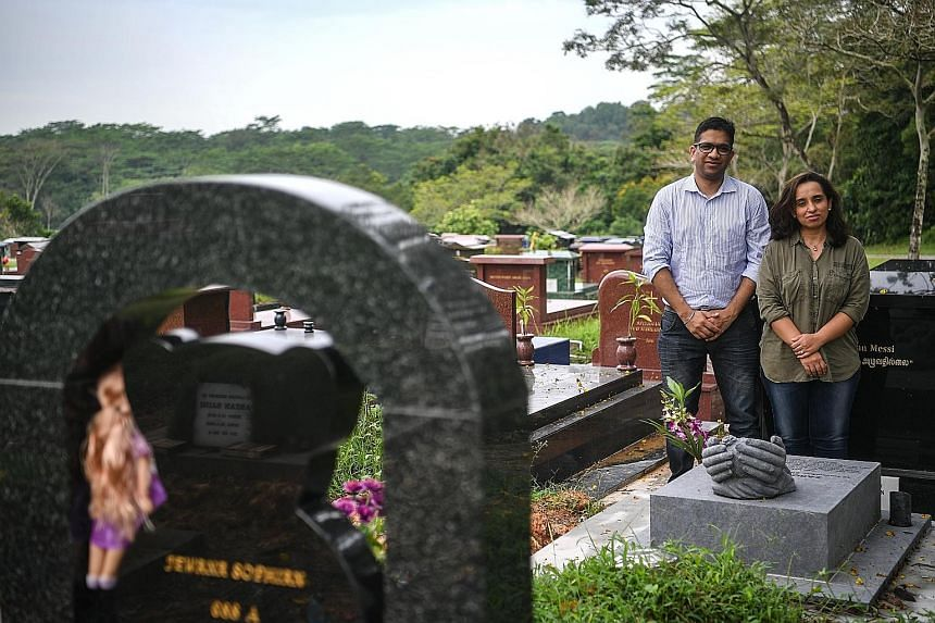 Above: Mr Sandeep Singla and his wife Neha Wilson at the grave of their late daughter Zarouhi (left).