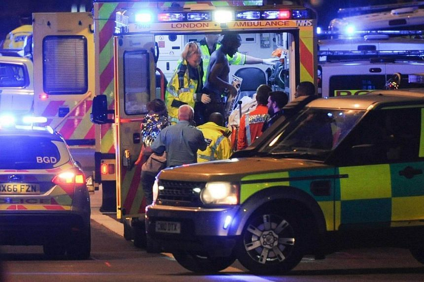 Members of the emergency services attend to victims of a terror attack on London Bridge in central London, on June 3, 2017.