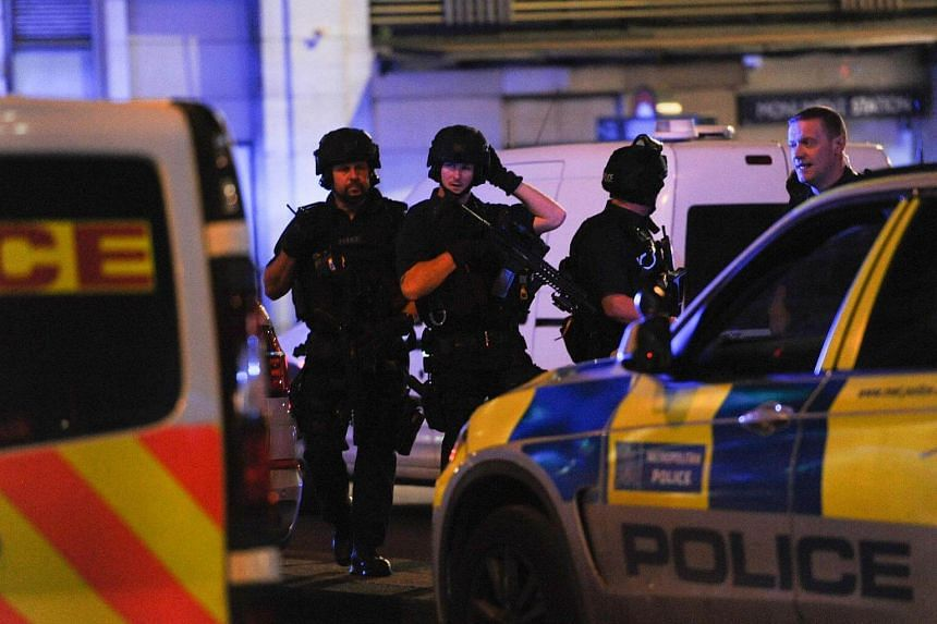 Armed police take position at the scene of a terror attack on London Bridge in central London, on June 3, 2017.