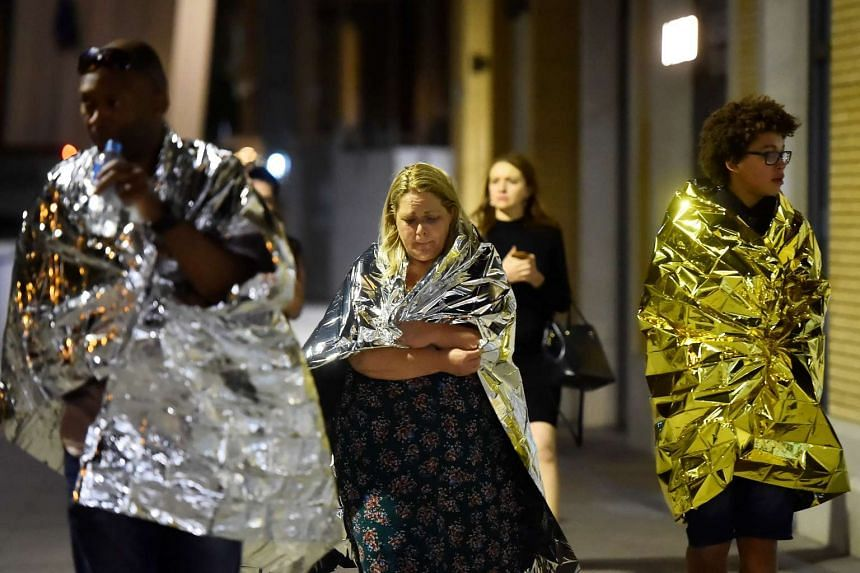 People flee as police attend to an incident near London Bridge in London, Britain on June 4, 2017.