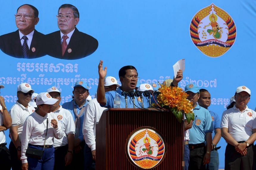 Cambodia's Prime Minister Hun Sen (centre) addresses supporters of the Cambodian People's Party on June 2, 2017.
