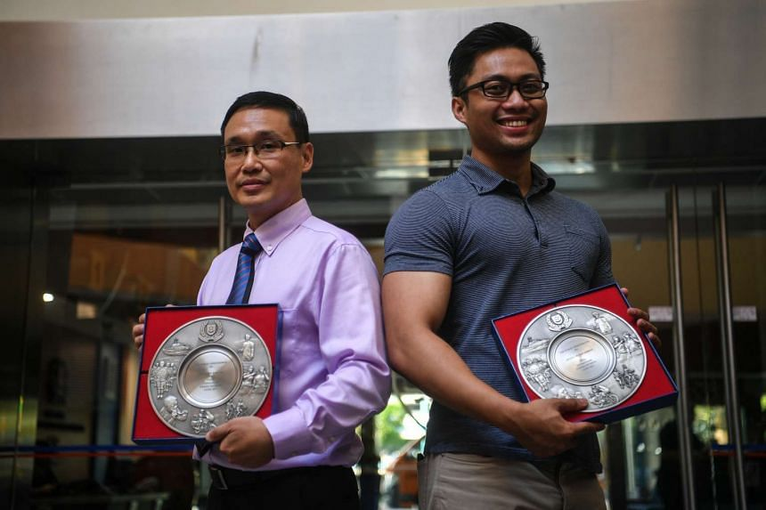 Four members of the public, including Mr Yeo Swee Khiank (far left) and Mr Zulhilmi Sabariman, received the Public Spiritedness Award at a ceremony held at the Jurong Police Division yesterday.