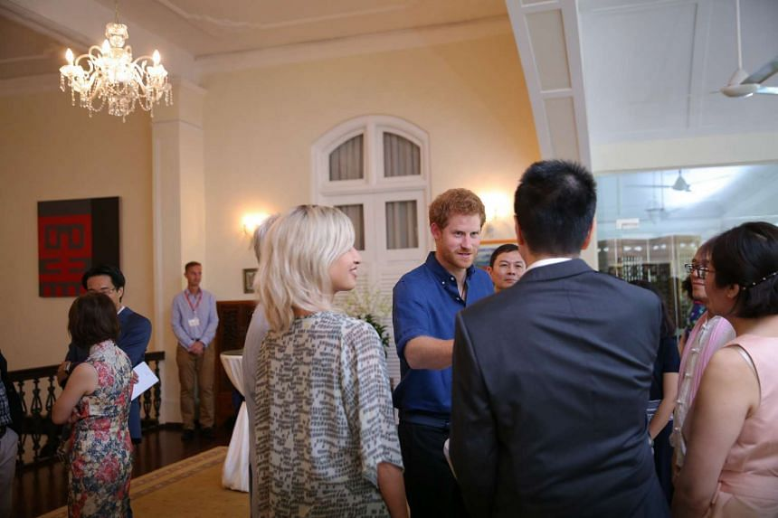 Prince Harry speaks to staff and volunteers at an Action for Aids reception at Eden Hall.