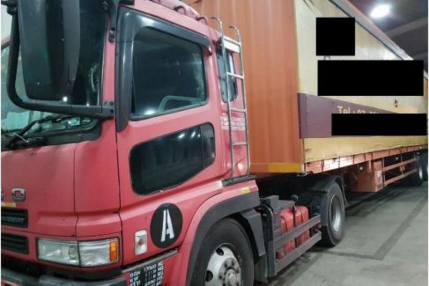 Side view of truck used in the smuggling of duty-unpaid cigarettes.