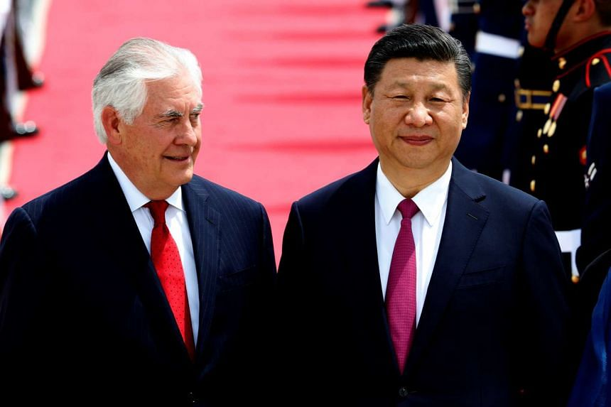 US Secretary of State Rex Tillerson (left) stands with China's President Xi Jinping after he arrived at Palm Beach International Airport in West Palm Beach, Florida on April 6, 2017.