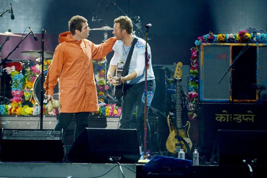 Liam Gallagher (left) and Chris Martin performing during the One Love Manchester benefit concert, on June 4, 2017.