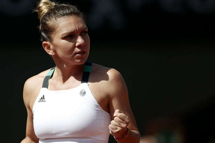 Simona Halep of Romania reacts as she wins against Carla Suarez Navarro of Spain during the Women's singles 4th round match during the French Open tennis tournament at Roland Garros in Paris, France, on June 5 2017.