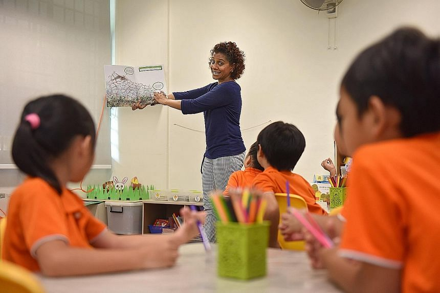 My First Skool teacher Shanthinayagi introducing her K2 class to the book A Crab, A Shell And A Little Help. The book about a hermit crab's quest for a new shell was written by Ms Han Rae Ann, Mr Bertrand Yan and Ms Natasha Hoong, and illustrated by