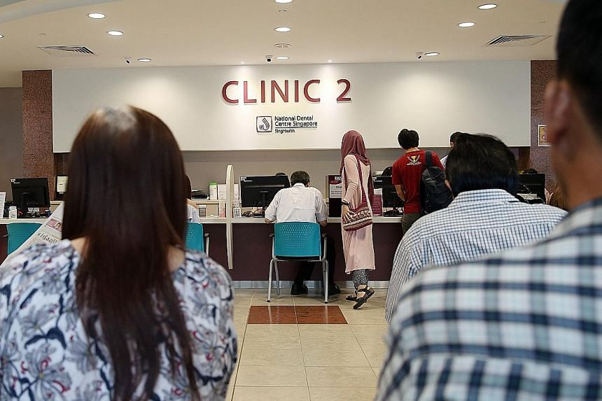 Patients waiting at a clinic at the National Dental Centre last Friday. Demand for subsidised dental care has grown, with the centre handling 160,849 patient attendances last year alone.