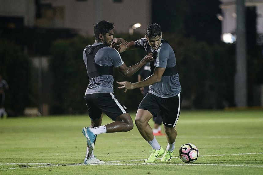 Irfan Fandi (right) trying to dribble past Hariss Harun in training last week. Before the glamour friendly comes a bread-and-butter qualifier.