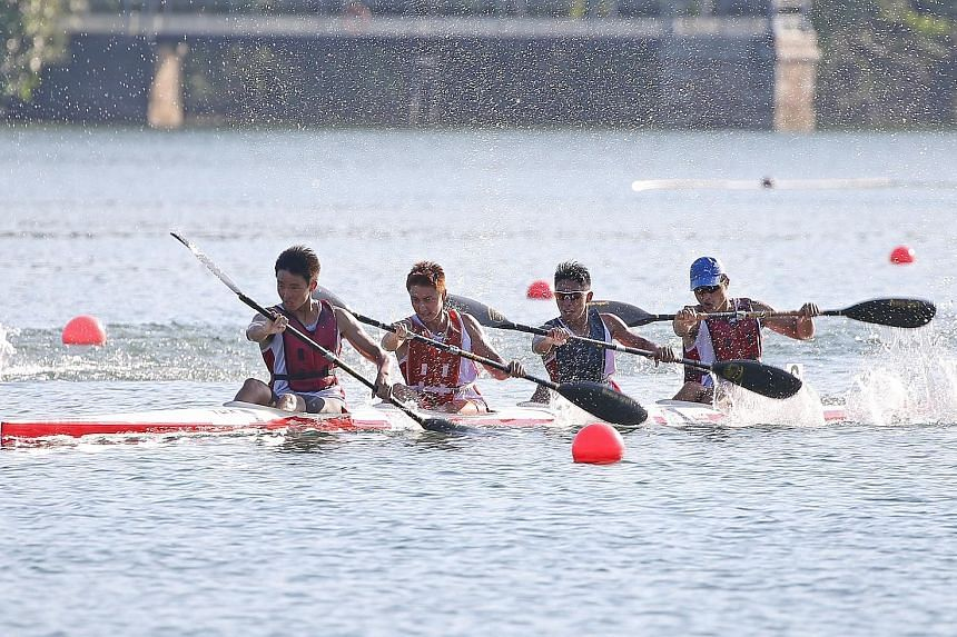 Lightning Kayaking Club's (from left) Julian Seow, Jack Smith, Jasmond Tan and Bill Lee on their way to winning the senior men's kayak quartets 200m race at MacRitchie Reservoir yesterday. The four of them, all 17 years old, came in ahead of the NTU team.