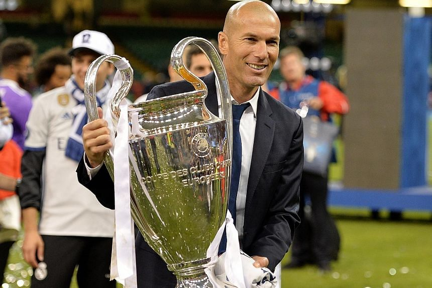 Real Madrid coach Zinedine Zidane holding the Champions League trophy aloft. Just 17 months into his tenure at the Santiago Bernabeu, the Frenchman has already eclipsed some of football's most hallowed names.