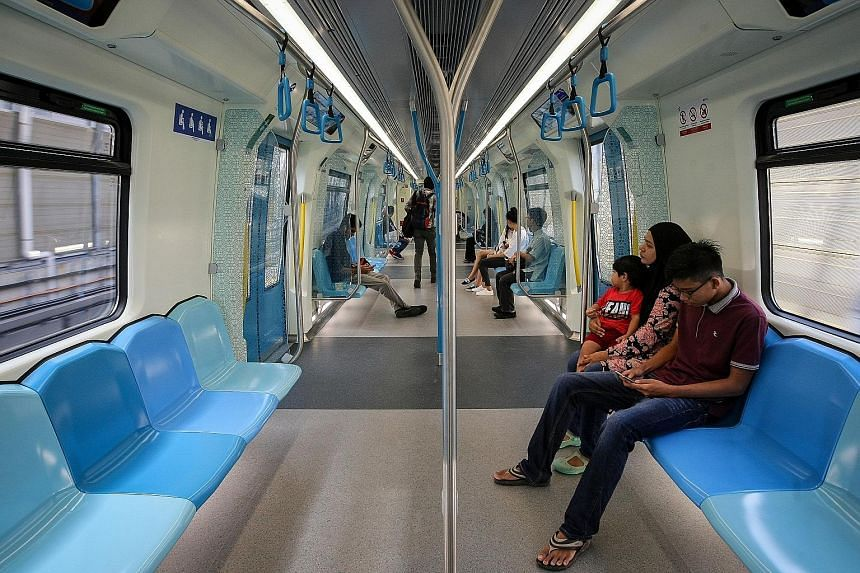 Passengers on an MRT train in Kuala Lumpur. The system and the Light Rail Transit have been expanded in recent years. The PR1MA scheme is targeted at first-time home owners with household income from RM2,500 to RM15,000. Since BR1M started in 2012, a
