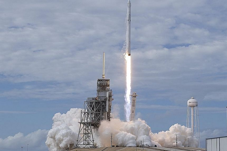 A Nasa photo showing SpaceX's Falcon 9 lifting off with the Dragon capsule from the Kennedy Space Centre on Saturday. Reusability is now seen as the key to affordable space missions.