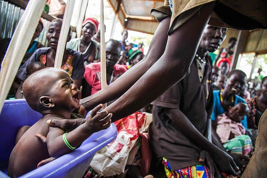 A malnourished child in a nutrition centre run by the International Rescue Committee in Panthau, Northern Bahr al Ghazal, South Sudan, one of the four countries facing massive hunger crises.