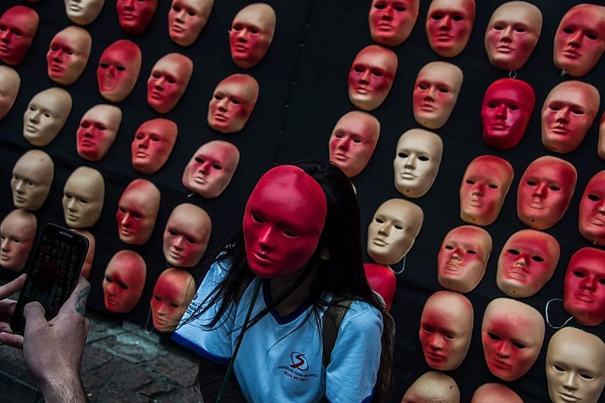 Masks representing Brazil's 594 congressmen and President Michel Temer put up as a protest against political corruption at the Museum of Art in Sao Paulo, Brazil.