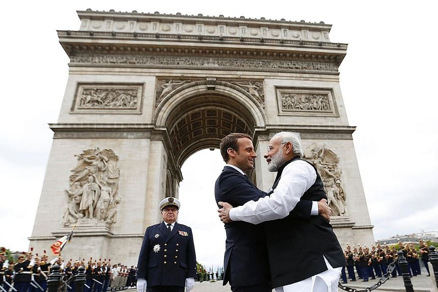 French President Emmanuel Macron and Indian Prime Minister Narendra Modi at the Arc de Triomphe last Saturday as Mr Modi ended a two-day visit to France.