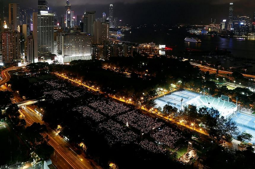 Tens of thousands of people taking part in a candle-light vigil to mark the 28th anniversary of the Tiananmen crackdown. Student unions continued their boycott of the vigil, saying its message is increasingly irrelevant to Hong Kong.