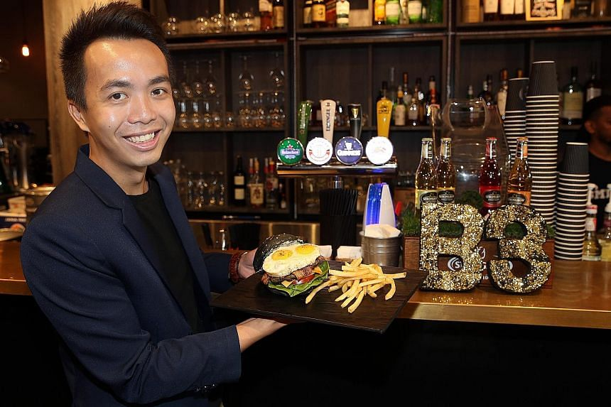 """SMU Alumni Association general manager Edwin Lim is also the manager of B3, which stands for """"burger, beer, bistro"""", and oversees its operations."""