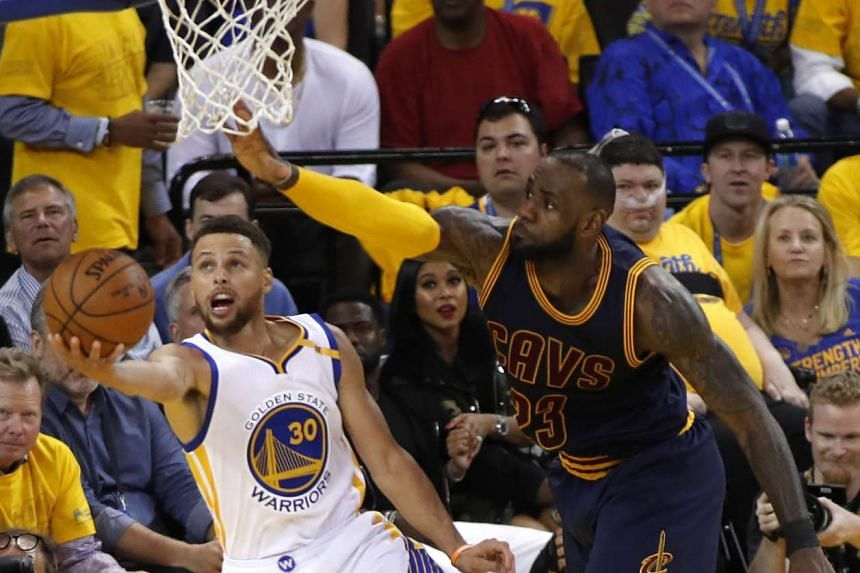 Golden State Warriors guard Stephen Curry (left) going to the basket against Cleveland Cavaliers forward LeBron James in Game 1 at the Oracle Arena in Oakland, California, on June 1. The two teams face off in Game 2 today.