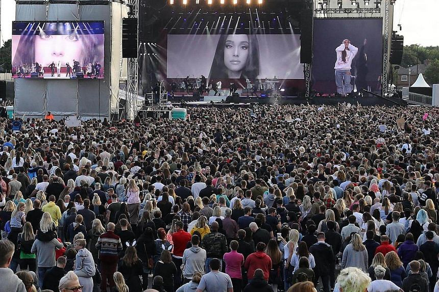 Ariana Grande on stage during her One Love Manchester concert at Old Trafford Cricket Ground in Manchester, Britain, on June 4, 2017.