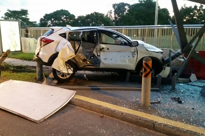 The car wrecked parts of a bus stop along Jurong Town Hall Road on Monday.