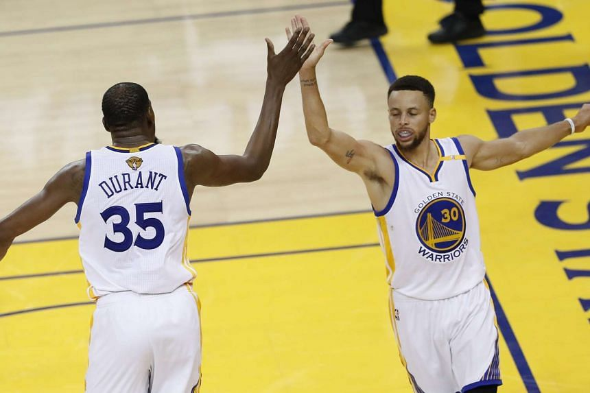 Golden State Warriors forward Kevin Durant (left) celebrate with teammate Stephen Curry against the Cleveland Cavaliers, on June 4, 2017.