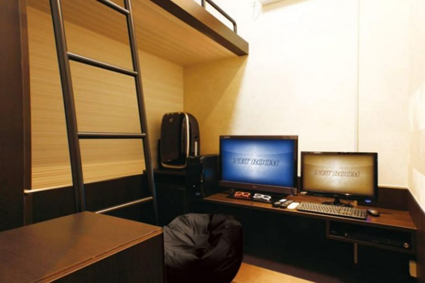 One of the rooms at Net Room, with a bed and computers.