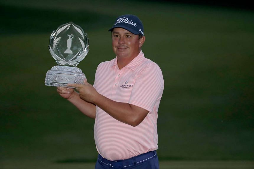 Jason Dufner posing with the tournament trophy after winning the Memorial Tournament, on June 4, 2017.
