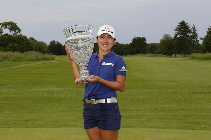 In Kyung Kim of South Korea holding the championship trophy after winning the ShopRite LPGA Classic.