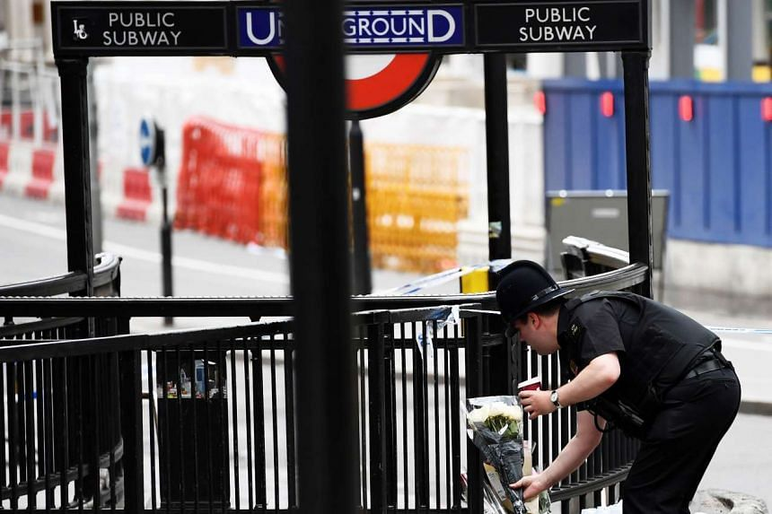 A police officer leaves flowers at London Bridge on June 4, 2017.