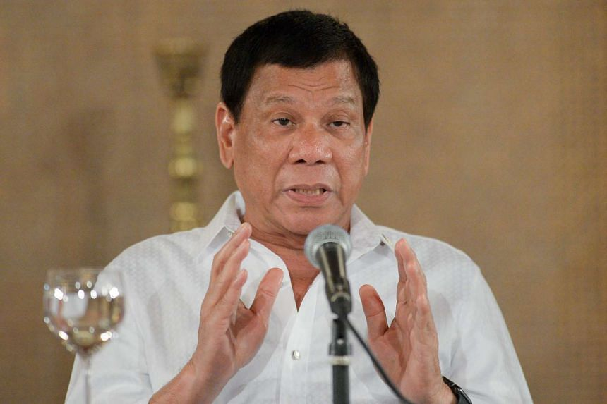 Philippine President Rodrigo Duterte gestures during a joint press conference at Malacanang Palace on Mar 13, 2017.