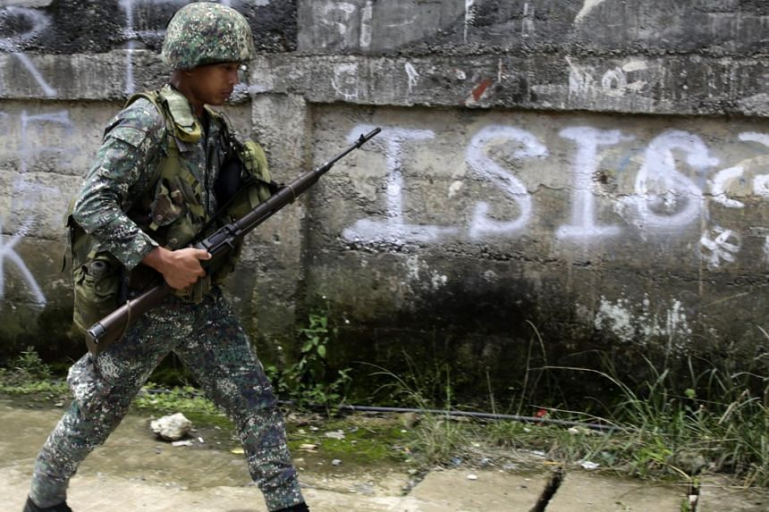 A Filipino government soldier walks on a street as fighting between Islamist militants and government forces continues in Marawi City, Mindanao Island, southern Philippines on June 2 2017.