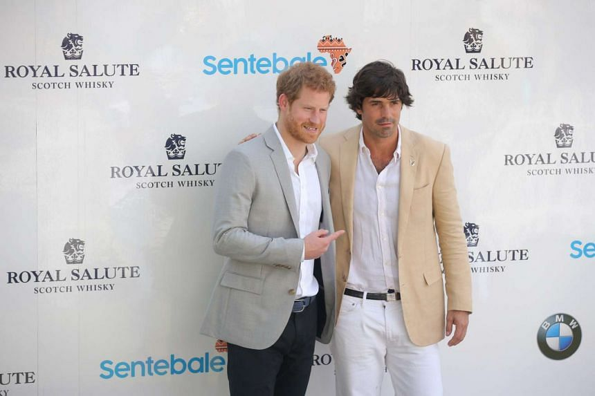 Prince Harry with St Regis polo player Nacho Figueras at the Singapore Polo Club.