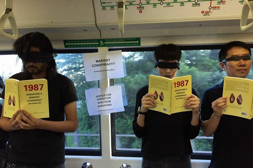 A group of about seven people were seen riding a train on the North-South Line while holding copies of the book and wearing blindfolds in a silent protest.