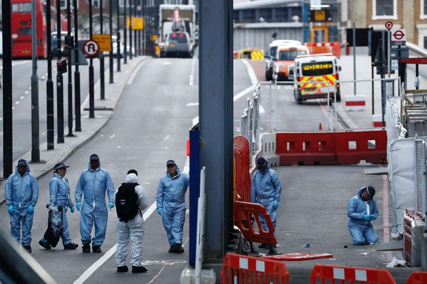 Police forensics officers work on London Bridge in London, on June 4, 2017.