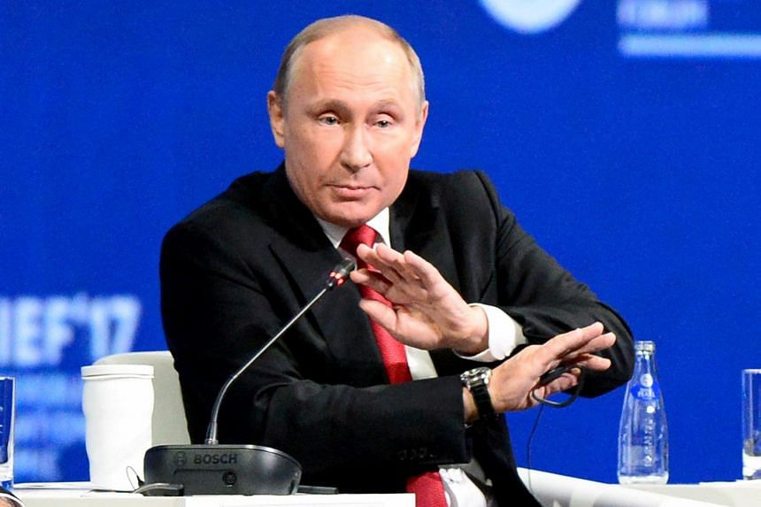 Russian President Vladimir Putin speaks during a session of the St. Petersburg International Economic Forum, on June 2, 2017.