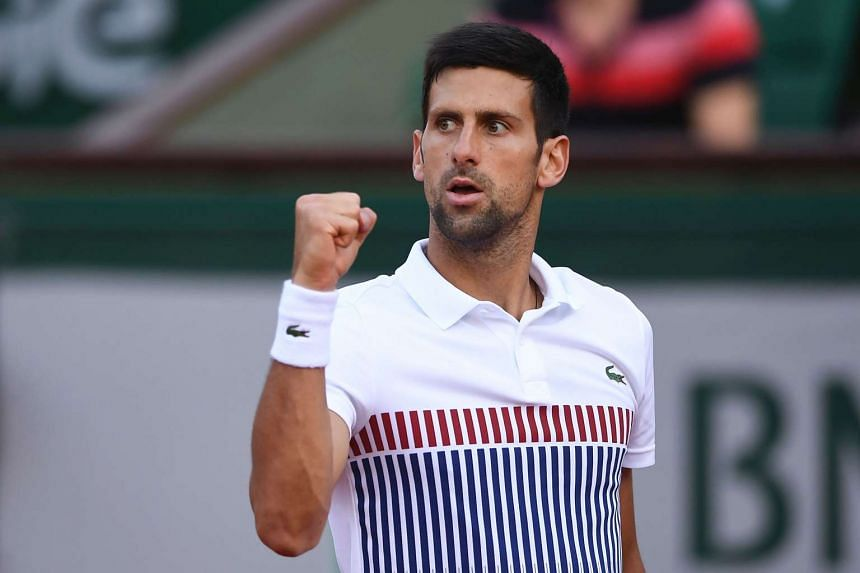 Serbia's Novak Djokovic celebrates after winning a point against Spain's Albert Ramos-Vinolas during their tennis match at the French Open on June 4, 2017.
